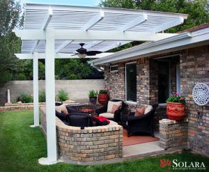 Protect your outdoor furniture under an adjustable patio cover.