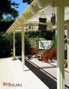 Relax and enjoy a sunny day on you patio under a Solara Patio Cover.